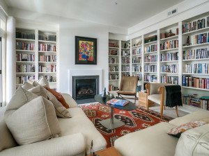 Striking living room with custom bookcases and gas fireplace