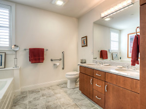 Master bath with dual vanities, soaking tub, shower and linen closet
